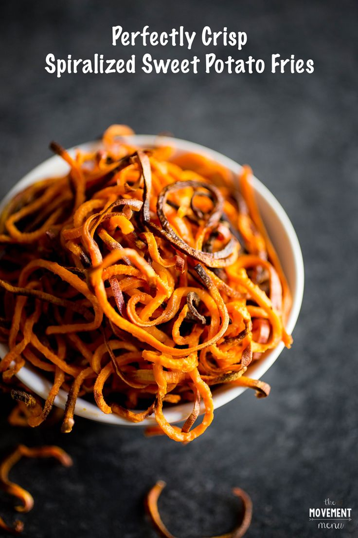 These Spiralized Sweet Potato Fries are perfectly crisp and pair so well with the Curry Aioli Sauce and green onions I paired with it! Healthy & delicious | TheMovementMenu.com