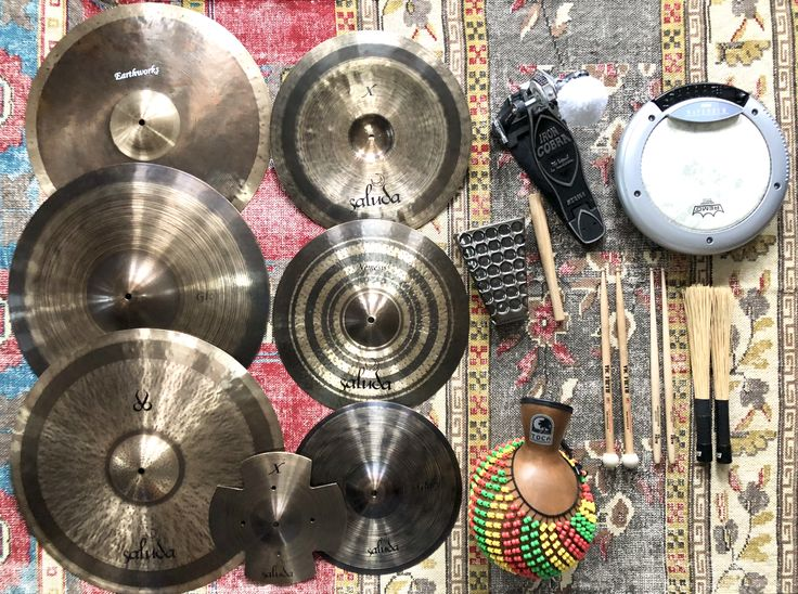 Saluda cymbals, Toca percussion, Tama Iron Cobra and Korg Wavedrum.