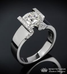 http://rubies.work/0651-ruby-rings/ whiteflash: tension setting engagement rings are so cool. the diamond looks like it's floating.