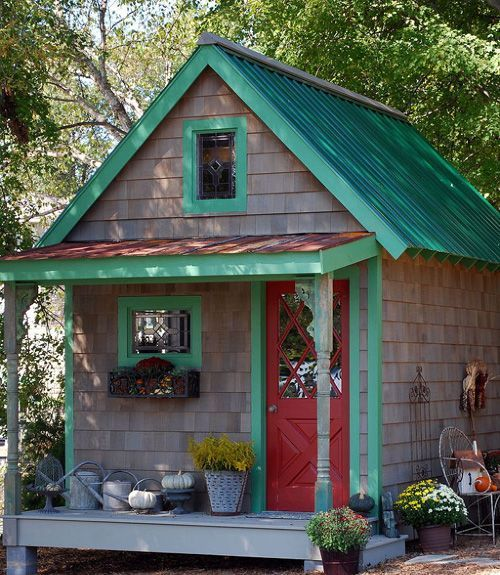 This bold little potting shed gets a full themed costume every season! For fall, planters of mums and pumpkins galore line its mini porch. Could you imagine a better spot to inspire your green-thumb?   - CountryLiving.com