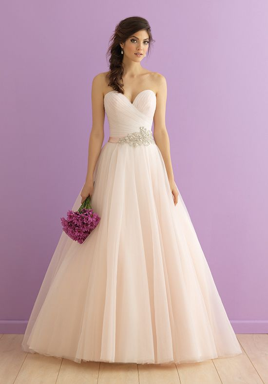 We never designed a tulle ballgown more delicate and feminine than this.