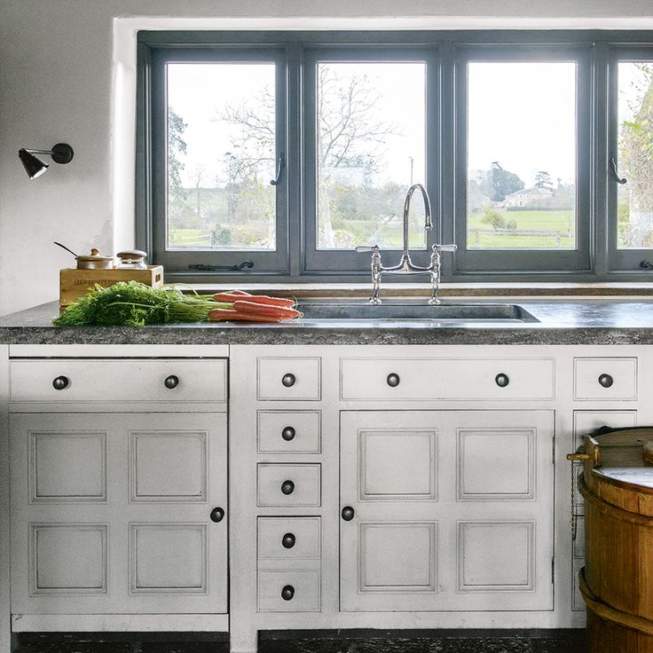 Hand-made white kitchen with blue painted window frames