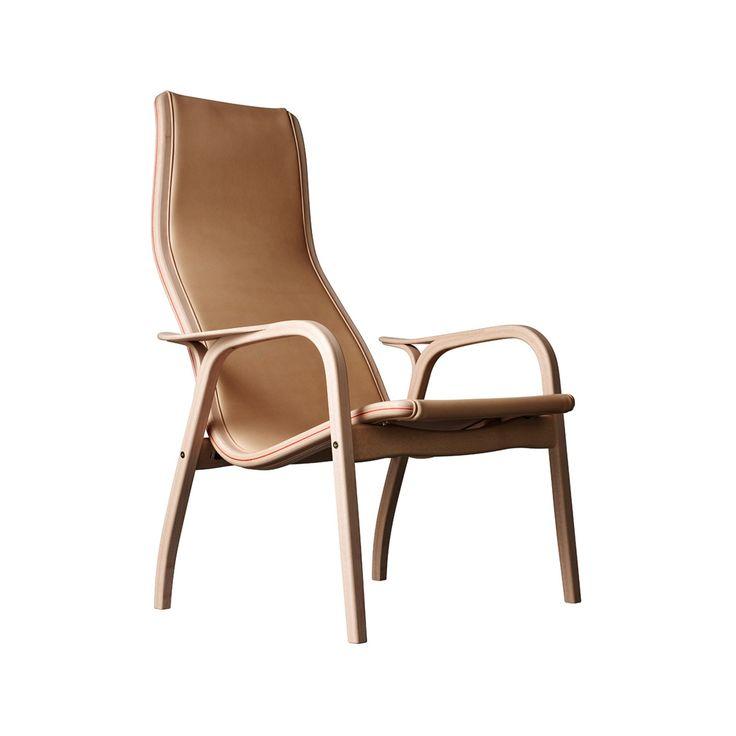 """Lamino by Nudie klädd i tärnsjöläder är en designklassiker producerad i begränsad upplaga. Fåtöljen är klädd i obehandlat läder som naturgarvats på Tärnsjö Garveri. Stommen är tillverkad i obehandlad bok med ett orange inslag, likt en söm längs hela stommen. """"Att ha gjort en bra stol är kanske inget dåligt livsverk"""".  Citatet kommer från Lamino-stolens pappa, Yngve Ekström. Och att säga stolen som röstades fram som århundradets svenska möbel av Sköna Hems läsare bara är en bra stol får ändå…"""