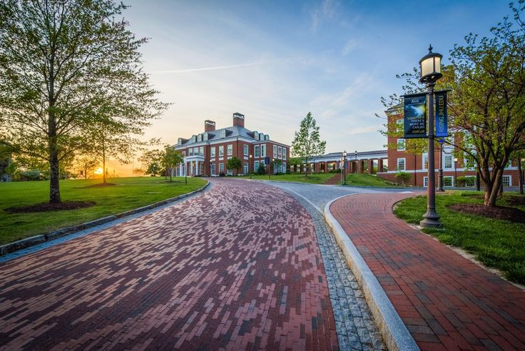 Driveway and Mason Hall at sunset at Johns Hopkins University, Baltimore, Maryland.