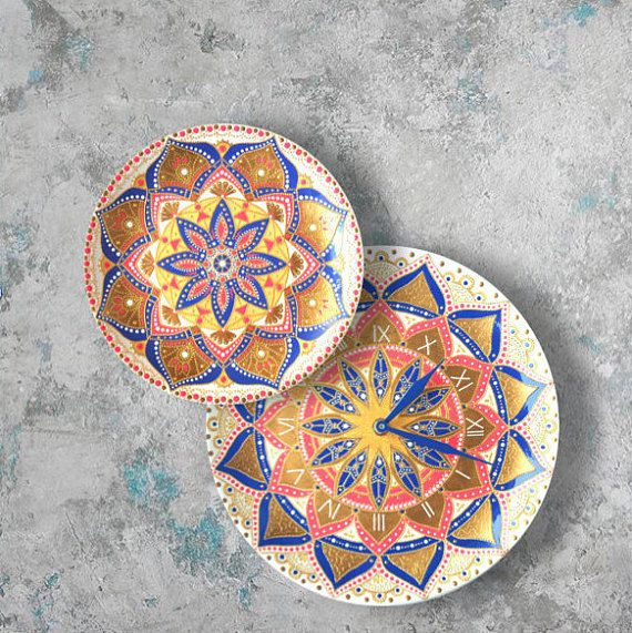 The set of two decorative plates (wall clock and plate) completely painted by hand makes a stunning visual effect. This dot art colorful mandalas painted on the ceramic plates. Wall hangings with blue and cyclamen accent is a unique decoration to your dining room or an original Mothers