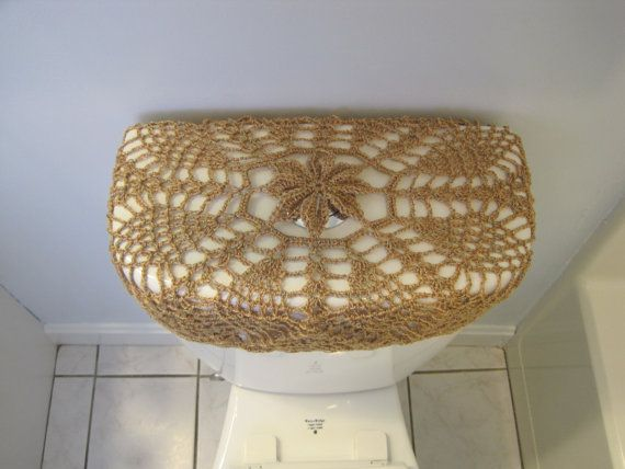 • Hand-crocheted with the same pattern, 95% acrylic/5% metallic (sparkles) • Fits any kind of toilet seat and tank lid (size:20 diameter) • Has a drawstring • Easy to put it on and remove it • Beautiful addition to your bathroom • Hand wash in cold water and lay flat to dry. $35/each. Please choose one of them when you order it. Thanks. All my items are made in a smoke-free home.
