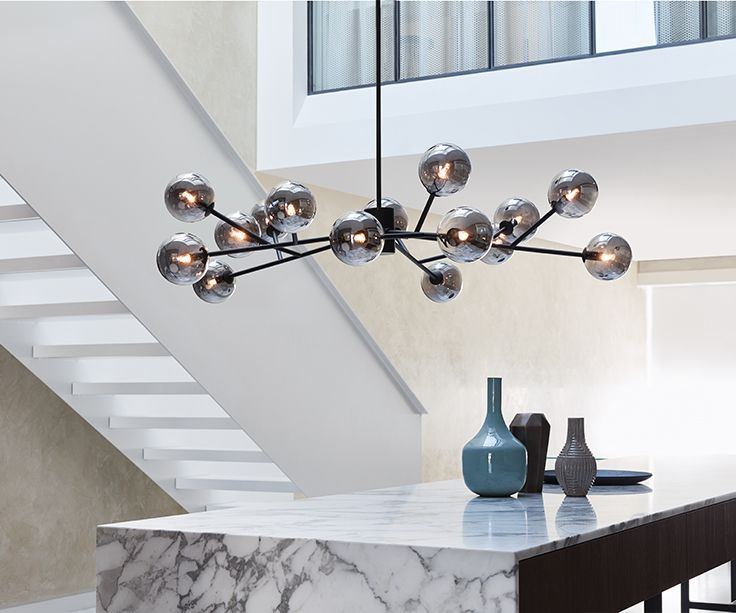 The Beacon Lighting Orion 15 light pendant in black with smoke glass.