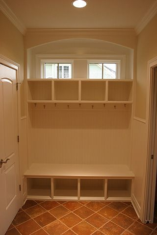 mudroom - like this on both sides of the door, and with the hidden shoe shelves