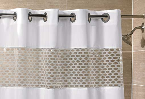 Only Hampton guests know—there's something extra special about our shower curtain. It's full of clever design details that refresh your bathroom, and make your routine sunnier. The innovative hook-less design eliminates the need for rings or clips, replacing them with built-in grommets that glide smoothly, and create an elegant, streamlined look. Enjoy more natural light while you bathe, thanks to a clear top panel. Each corner is weighted to help prevent water buildup. Offered in white, a…
