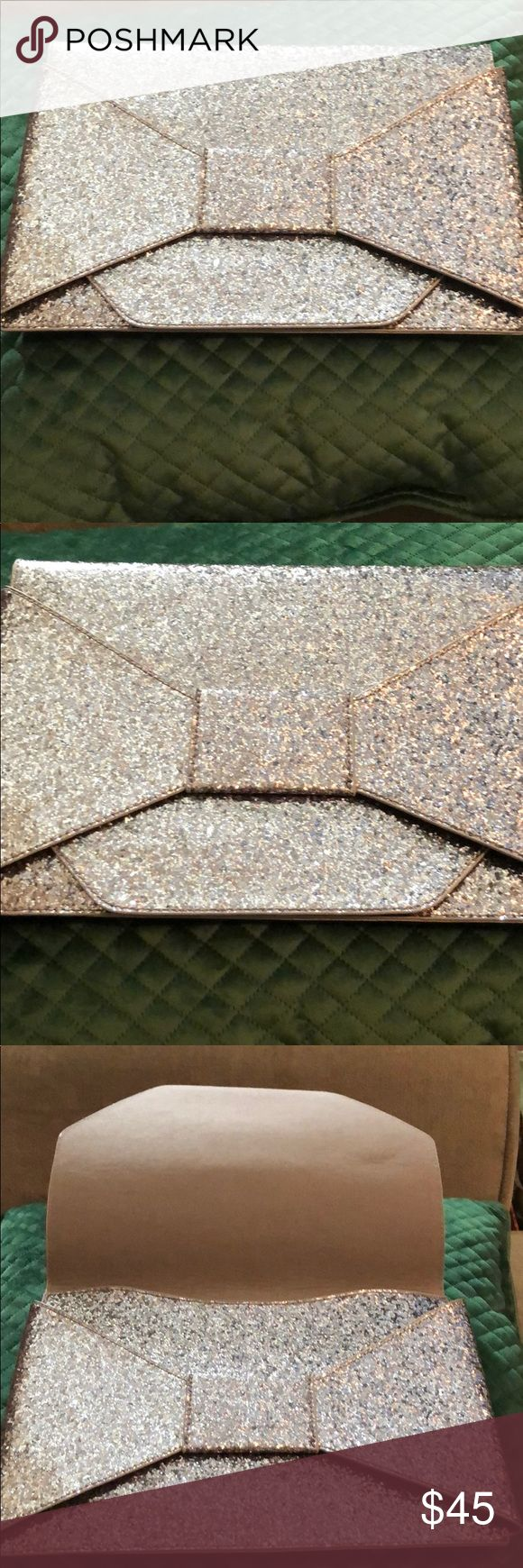 NWT! Banana Republic Silver Glitter Bag NWT! Banana Republic Silver Glitter Bag   Dimensions attached to pictures. Banana Republic Bags Clutches & Wristlets