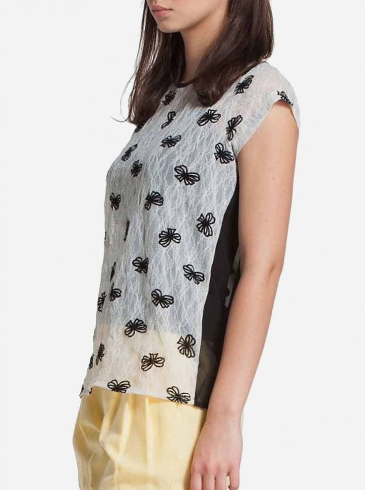 A black ribbon print on top of white color top. Features short sleeve and made of see-through fabric for a comfortable wear every day. It features twists and knots on the back in plain black color to add a surprise.