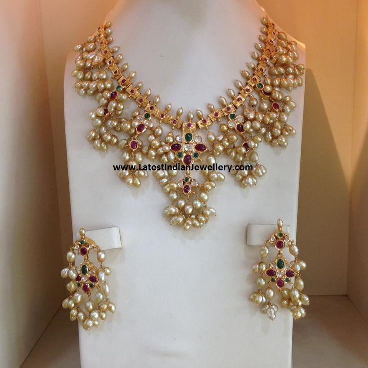 Traditional gottapusalu necklace with natural pearls, rubies and emeralds in 22 carat gold paired with pearl earrings. The pearl b...