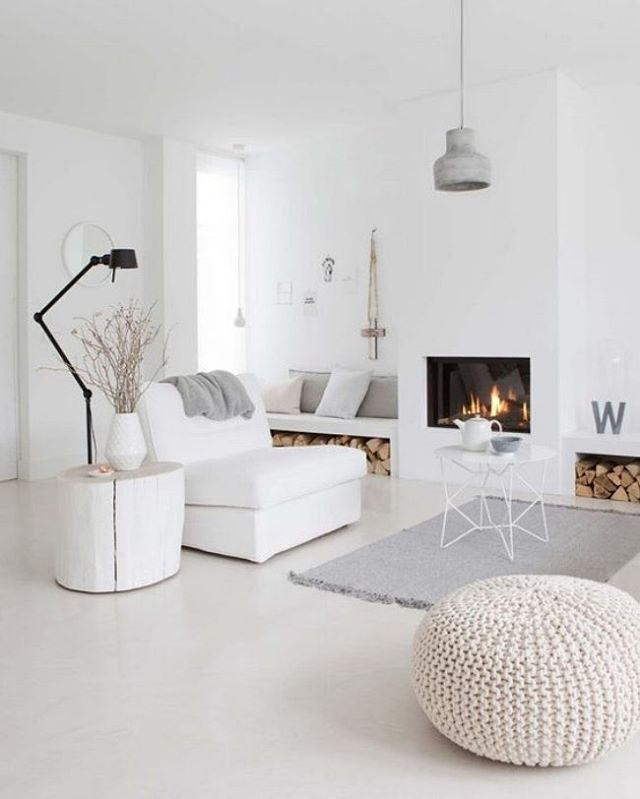 White Scandinavian lounge with fireplace.