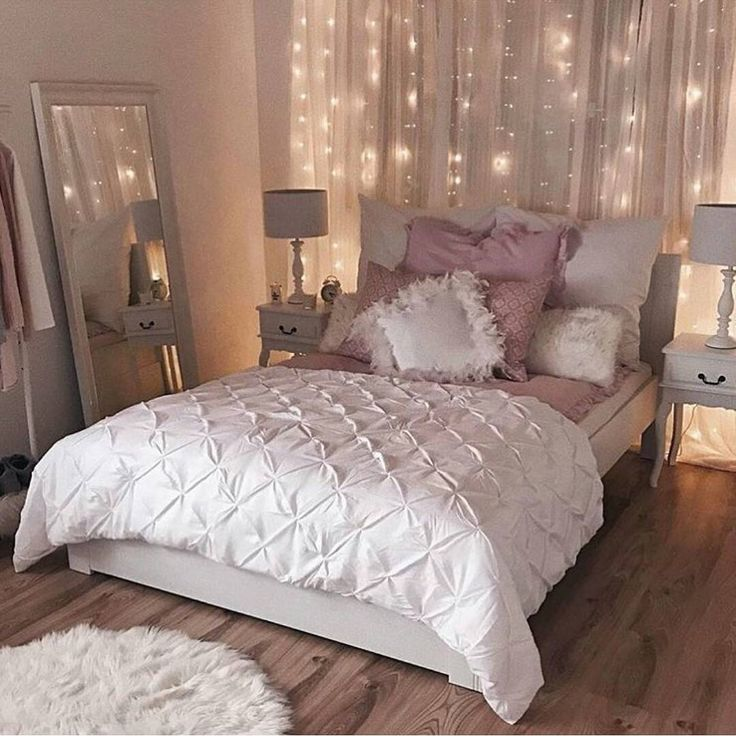 Romantic Bedroom Inspiration | Sophisticated White and Pink Bedroom | String Light Backdrop | White Duvet | Pink Accents