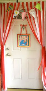 8/9/14 Streamers to get the circus tent look.  We alternated red and white on the vertical blinds.  Big impact for small amount of money.