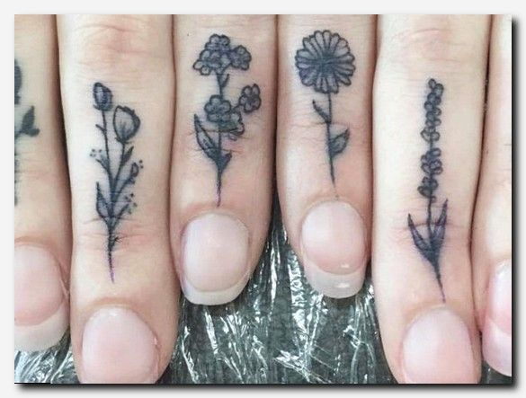 These tiny floral tattoos make up a flower garden on this girl's hand, and we…