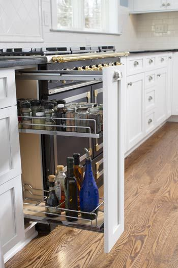 Pull out spice rack in action! | Kitchen cabinet ...