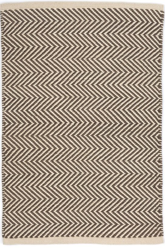 The thickest of our indoor/outdoor PET rugs, this contrasting ivory and charcoal zigzag pattern offers subtle geometric interest on a durable, easy-care floor covering for the porch, patio, kitchen, or hallway.Made of 100% PET, a polyester fiber made from recycled plastic bottles.In order to achieve its rustic charm, this rug has been woven with large-diameter yarns. Consequently, slubs, knots, and other imperfections inherent to the hand-weaving process may be more visible on this style of…