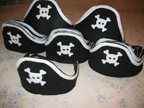 I just finished making some felt pirate hats, they were so simply to make....  that I made a total of twenty.... Are they not so adorable?  ...