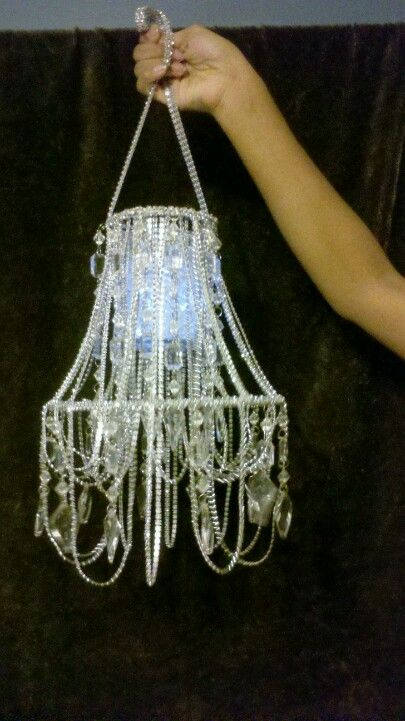 Made it out of a old lamp shade! For my daughters room:)