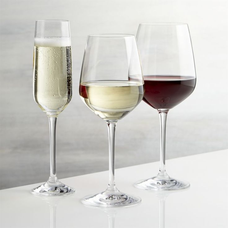 Shop Nattie Wine Glasses. Nattie's tulip-shaped bowls square up just a bit to put a modern angle on classic glassware.
