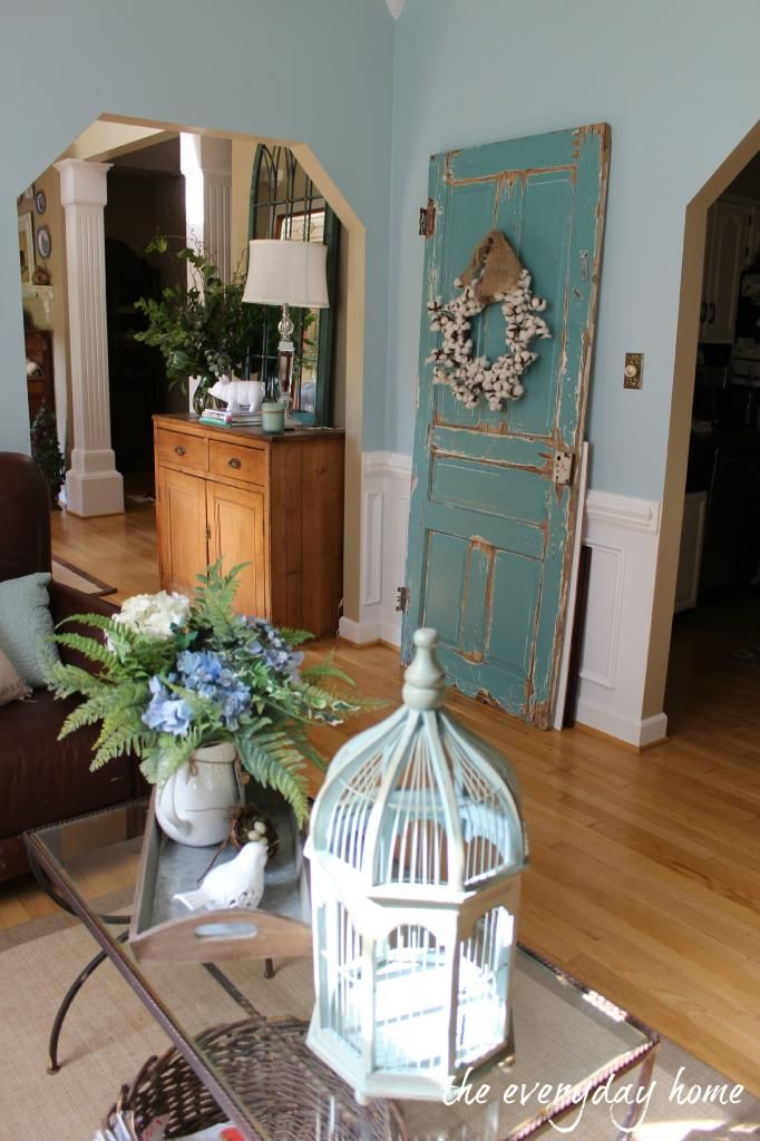 LOVE this blue door with a cute cotton wreath from The Everyday Home! Come see her cozy home tour here: http://www.everydayhomeblog.com/2013/07/hometour.html