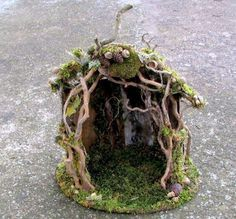 Sweet fairy house made of twigs and moss