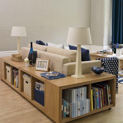 Pine shelves behind a beige sofa