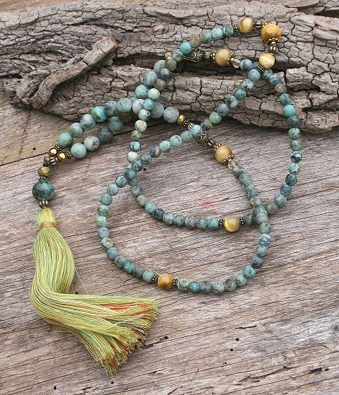 Mala necklace made ​​of 6 and 8 mm - 0.236 and 0.315 inch, beautiful frosted African turquoise gemstones. Together they count as 108 beads. The mala is decorated with two Nepalese beads, butter yellow tiger eye, citrine and hematite - look4treasures on Etsy