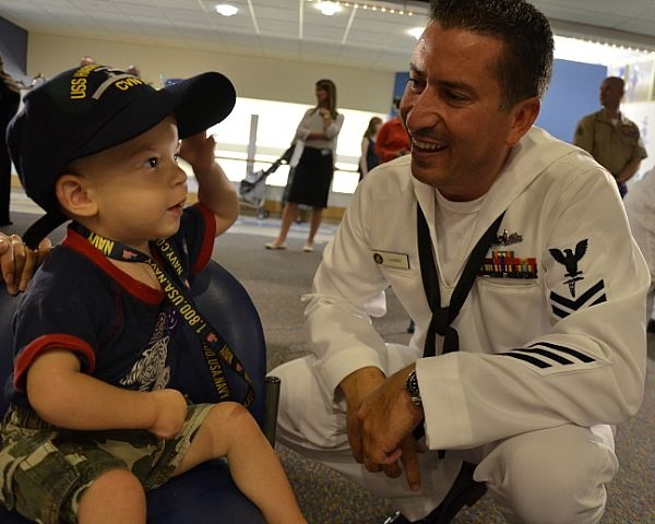 Hospital Corpsman 2nd Class Charles Landry, assigned to Navy Operational Support Center Austin, gives a boy a Navy ball cap at the Children's Hospital in Boston as part of Caps for Kids during Boston Navy Week.: For Kids, Ball Caps, Hospital Corpsman, Boy, Navy Photo