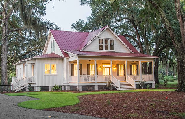 like everything about this house, porch, red roof, exposed rafters