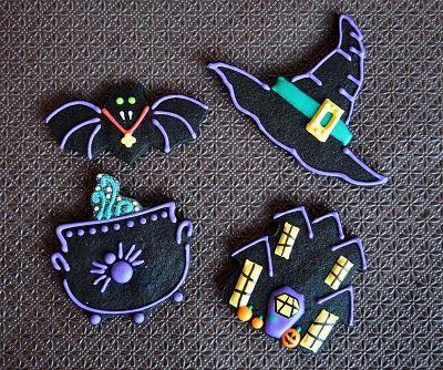 Black (chocolate) halloween cookies Repinned By: #TheCookieCutterCompany