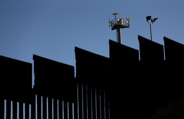 Donald Trump Reportedly Suggested Covering Border Wall With Solar Panels - Surveillance cameras tower above the U.S.-Mexico border fence at Playas de Tijuana in Tijuana, Mexico. (Justin Sullivan via Getty Images)
