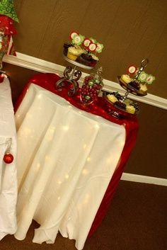 White Lights underneath white tablecloth ~ Decor Ideas ~ Lime, Red, White, and Silver Christmas Party | best stuff