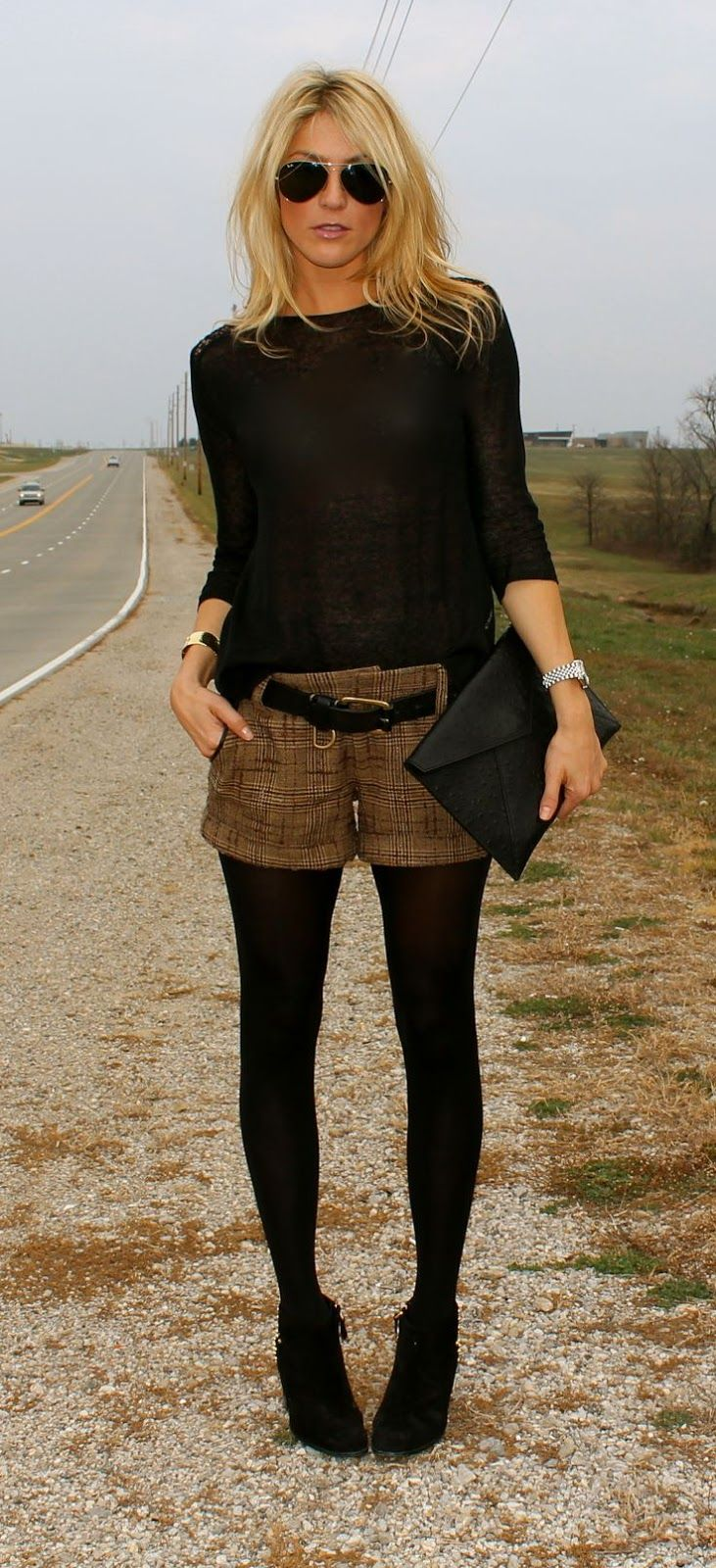 Street fashion black shirt, brown plaid shorts and tights