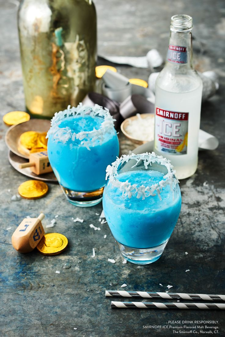 Cold weather got you wishing you were on a sunny beach somewhere? Get the best of both worlds with this Holiday coconut drink. Smirnoff Ice original and Blue Curacao make the Frosty Coconut cocktail, perfect for wintertime parties -- Christmas, Hanukkah, Kwanza or just a quiet night in with friends.   The Frosty Coconut Recipe:  ½ Bottle Smirnoff Ice Original .5 oz Blue Curacao .5 oz Coconut Milk Coconut Shaving For The Rim (Optional)