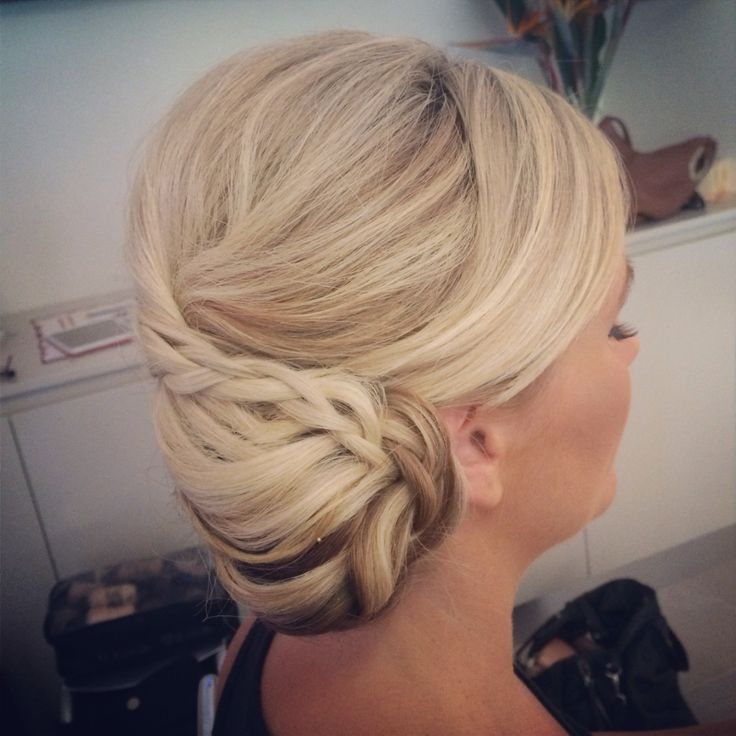 Pretty bridesmaid hair style side bun with plaits. Hair by Jennifer Mountain
