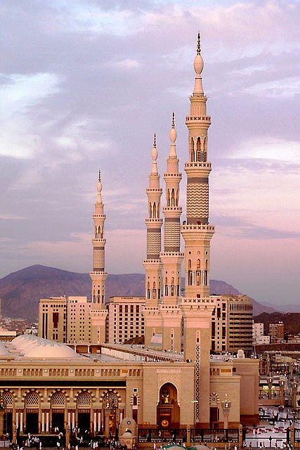 Minarets of the grand and historic Prophet's Mosque in Medina, Saudi Arabia.