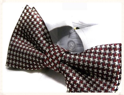 Mens coffee crisscross bowtie. Make's a great change from the traditional grooms wear at a wedding. Unique groom's bowtie only £7.50 each. www.picketfenceweddings.co.uk
