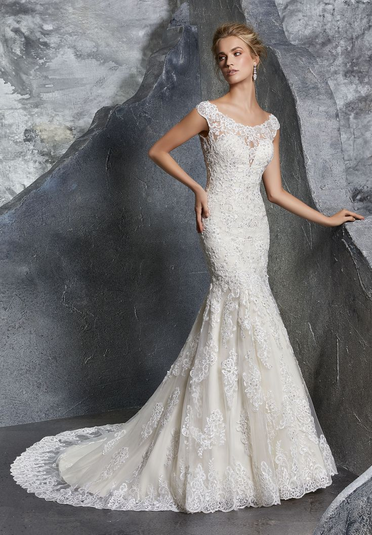 low cost wedding dresses in atlantga%0A This Mori Lee Bridal      Keely trumpetstyle wedding gown is adorned with  beaded Alencon lace  with cap sleeves edging the portrait neckline and  illusion