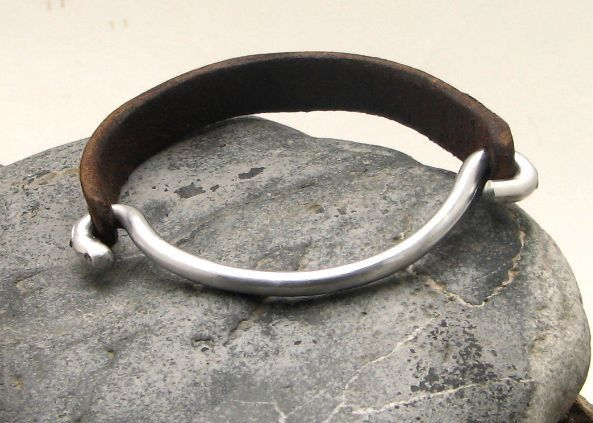 FREE SHIPPING Men's leather bracelet Brown leather men's bangle bracelet with metal work clasp. $27.00, via Etsy.