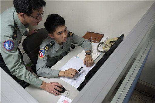 taiwan military forces | ... at a recruitment center in Taipei, Taiwan. AP PHOTO/WALLY SANTANA