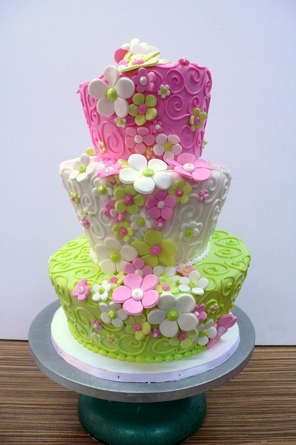 Love this one! Floral themed, pink, white and green cake