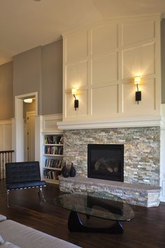 Fireplace stonework + molding above mantel. I love this! I know it doesn't work since our fireplace sits on the ground, but mantle and molding would work for fireplace in master!