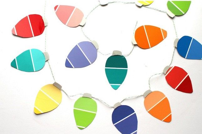 The next time you're at the hardware store, swing by the paint department + snag a bunch of swatches to make this Christmas light garland.