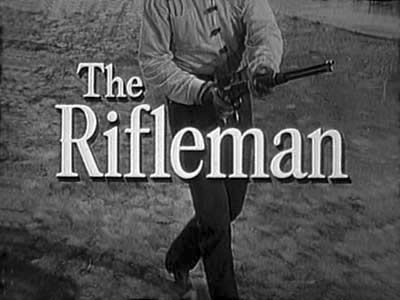THE RIFLEMAN (1958-1963; ABC, USA; theme by Herschel Burke Gilbert). A very accomplished western theme that begins with a staccato hail of bullets and majestic fanfare. A short but sweet classic. The outro gives a sense of how lovely and expansive the theme is. (KevinR@Ky)