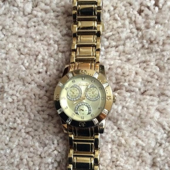 SALEGold Relic Watch with Bling! Gold relic with scratches on gold, see pic. Water resistant, stainless steel. Relic a division of Fossil. Sized. No additional links. Relic Accessories Watches