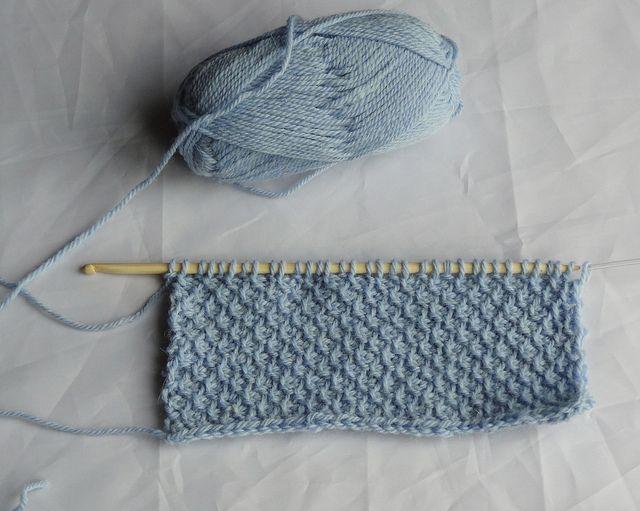 Moss Stitch - Tunisian Crochet.  Sometimes called honeycomb stitch. Alternate Tunisian simple stitch (tss) with Tunisian purl stitch (tps). Row 1 tss, tps, repeat.  Row 2 tps, tss repeat.