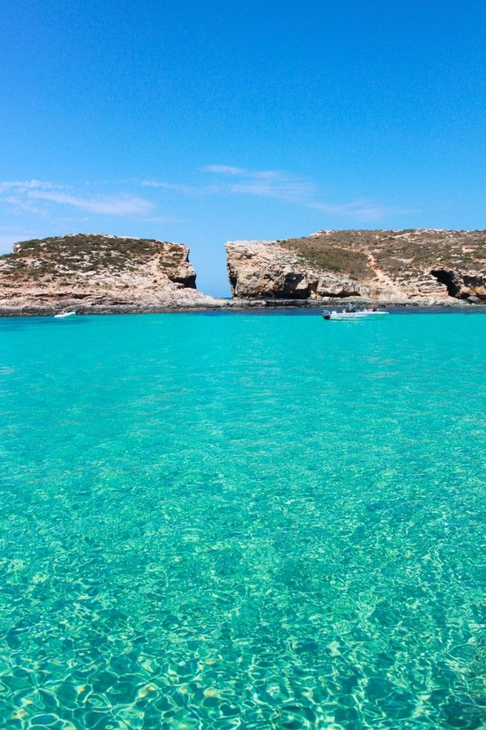 Blue Lagoon, Comino island. I've been here! Bluest clearest water I've ever seen. Stunning.