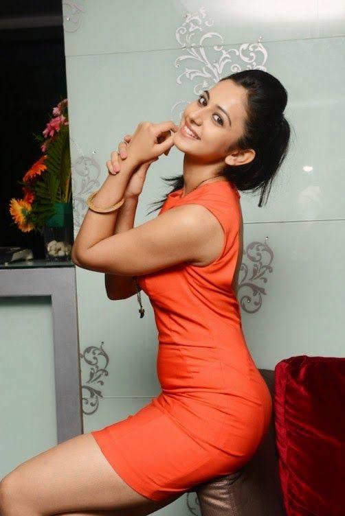 RAKUL PREET SINGH Photos Orange Dress
